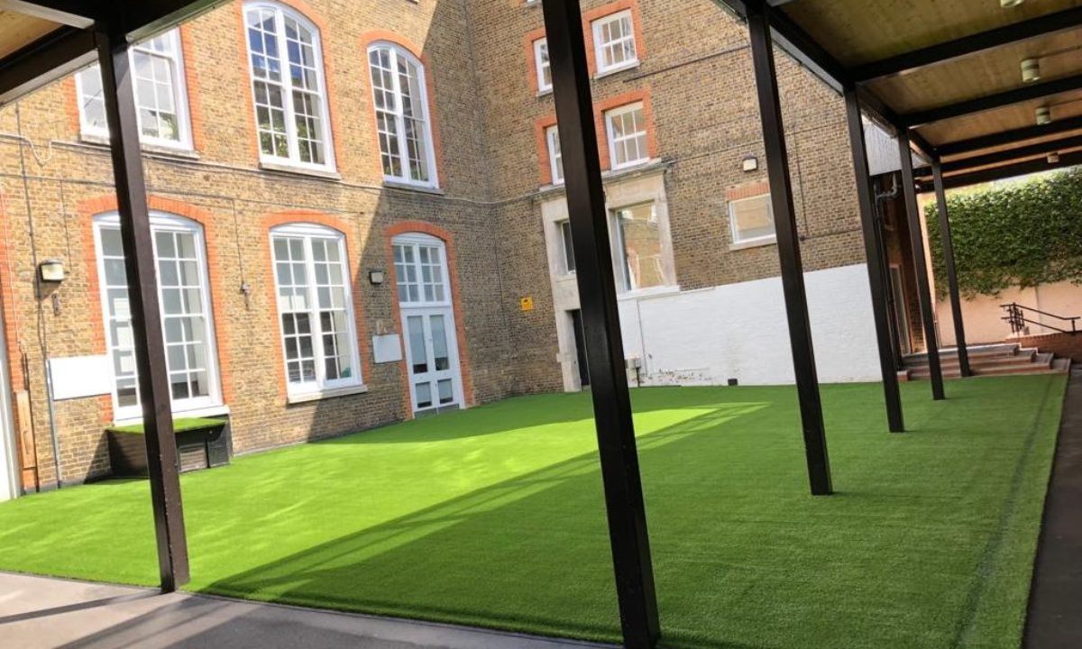 Courtyard with artificial grass at primary school
